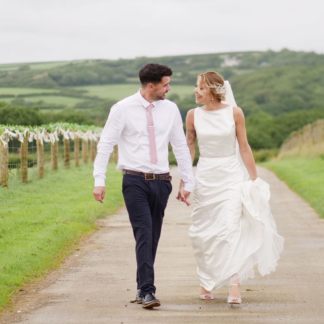 Bride and Groom walking the entrance to Milton Barn : Wedding Venue, Bude Cornwall